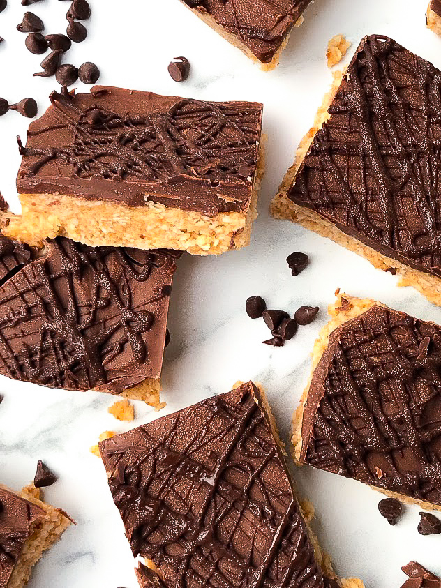 healthy no bake samoa cookie bars cut into squares with mini chocolate chips