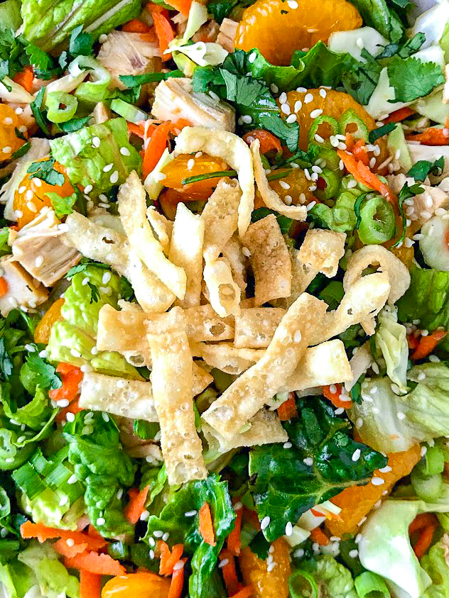 Close up picture of wonton strips on a Chinese chopped chicken salad