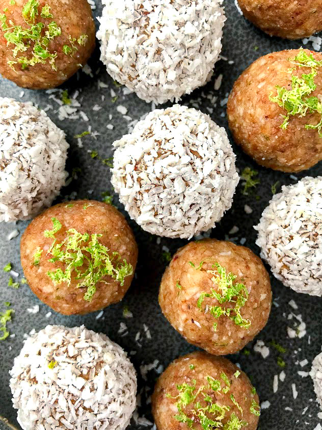 Close up picture of lime protein bites with some covered in shredded coconut and others topped with lime zest