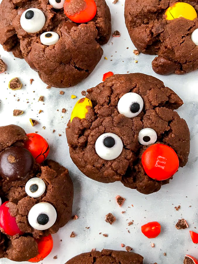 A close up picture of Halloween monster cookies. They're an easy and fun treat that are full of chocolate and peanut buttery goodness!