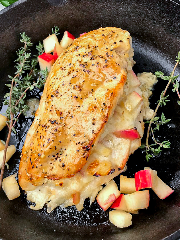 Sweet apple and brie stuffed chicken that is seared in the cast iron and finished in the oven! It's an easy meal that will impress your guests.