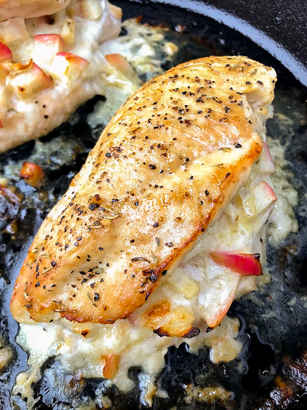 This easy stuffed chicken dish is perfect for fall and winter. It's filled with sweet honeycrisp apples and buttery brie cheese, brushed with a maple glaze and then baked in a cast iron pan.