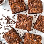 Brownies made with only chocolate hazelnut butter, eggs, cocoa powder, vanilla, coconut sugar, coconut flour, baking soda and chocolate chips. They're completely gluten free and refined sugar free!