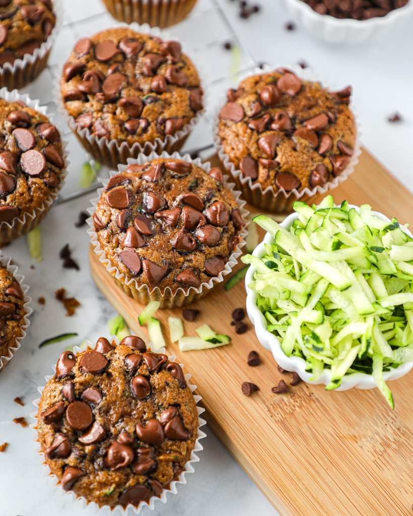 A muffin recipe that's made with fresh zucchini, chocolate and no oil/butter or dairy! They're healthy enough for breakfast yet decadent enough for dessert!