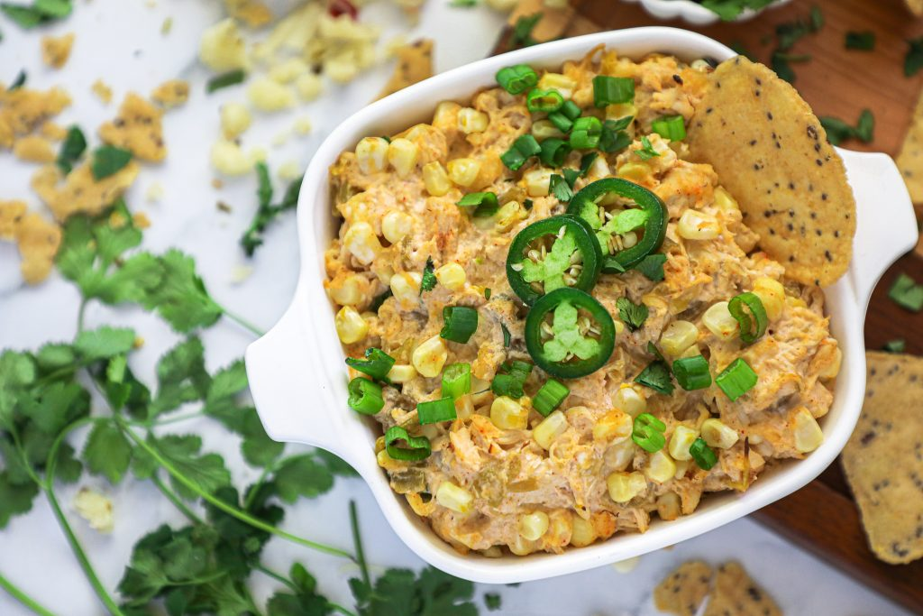 This hot baked corn dip is full of Mexican flavors and lightened up by switching out a few main ingredients. You'll definitely want to serve this at your upcoming Super Bowl party!
