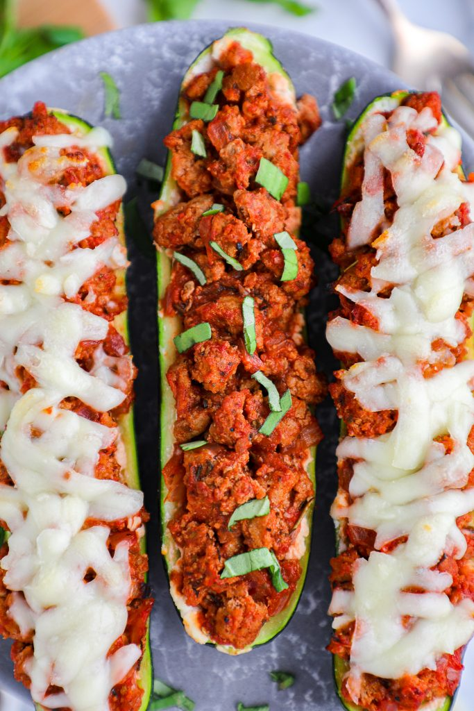 Dairy free zucchini boats! These boats are layered with a ricotta and parmesan mixture and a healthier meat sauce made with homemade marinara! Don'r forget the fresh basil on top!