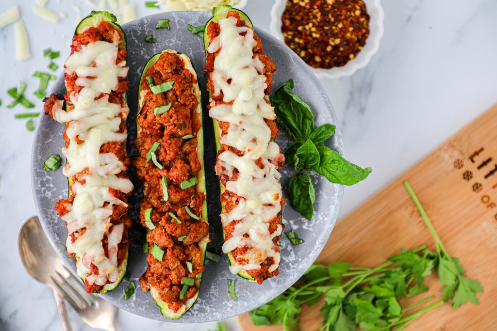 3 hollowed out zucchini boats filled with creamy ricotta cheese and a hearty meat sauce. They're then topped with mozzarella cheese and baked to perfection!