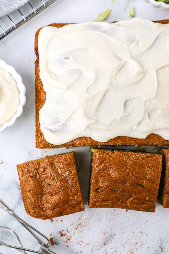 Easy spiced zucchini cake with cream cheese icing. This is one sinple recipe you'll want to keep in your baking arsenal!