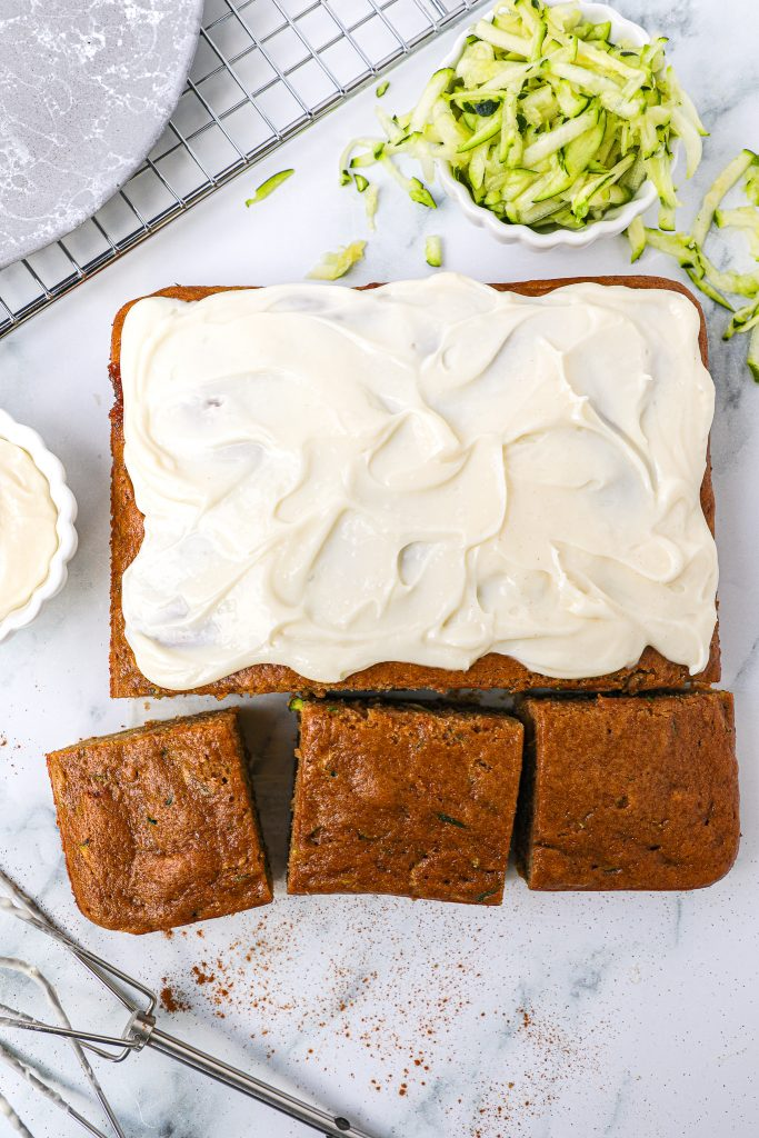 Healthy zucchini cake spiced with cinnamon and nutmeg. It's incredibly easy to make and then smeared with a protein packed cream cheese frosting!