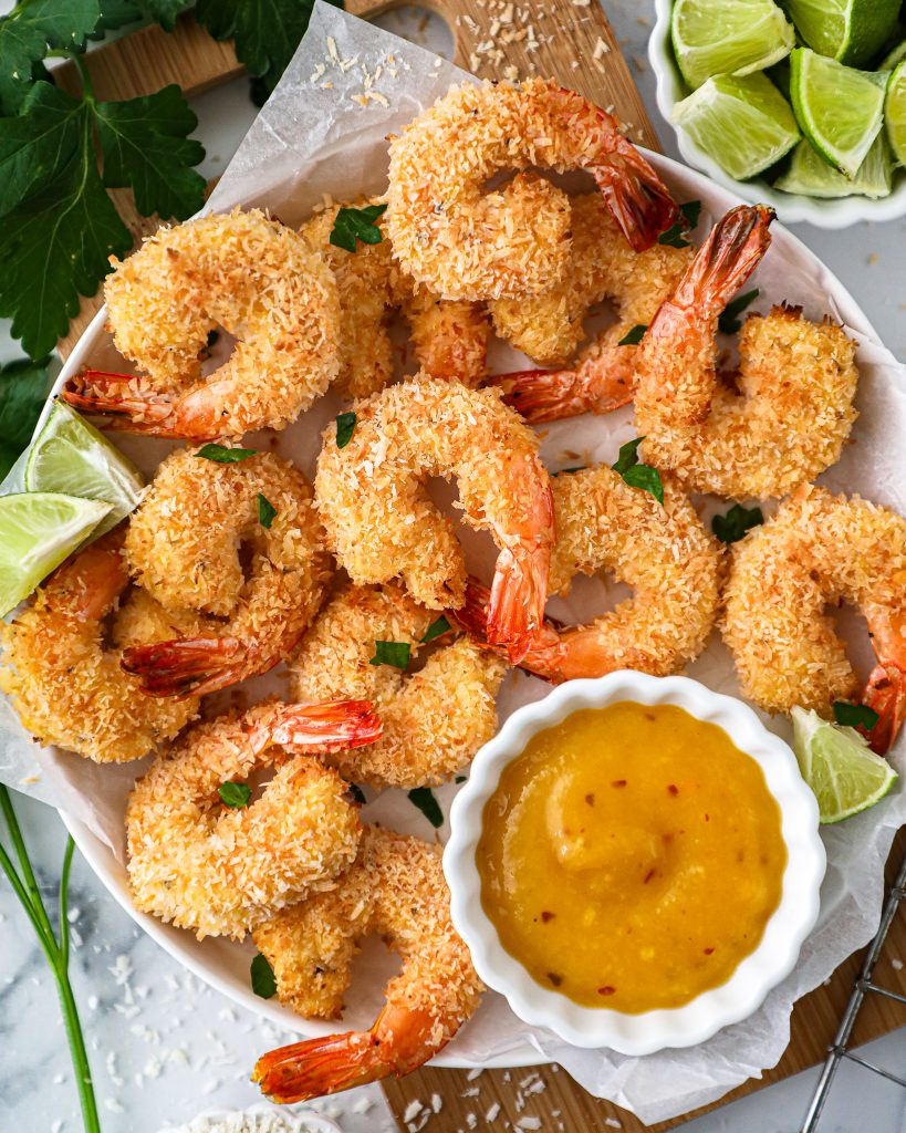 Baked coconut shrimp that are made with minimal ingredients and are completely gluten free, dairy free and Paleo approved. They're also served with an easy mango dipping sauce!
