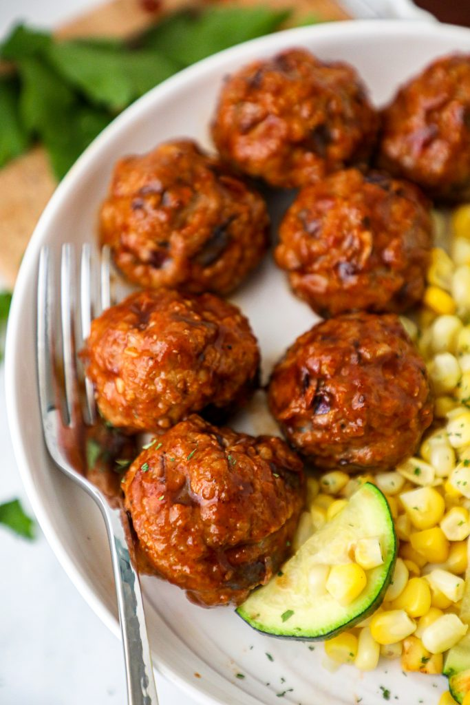 Quick and easy bbq meatballs that are oven roasted and can be served in the crock pot! You'll definitely want to serve these at your next potluck/party!