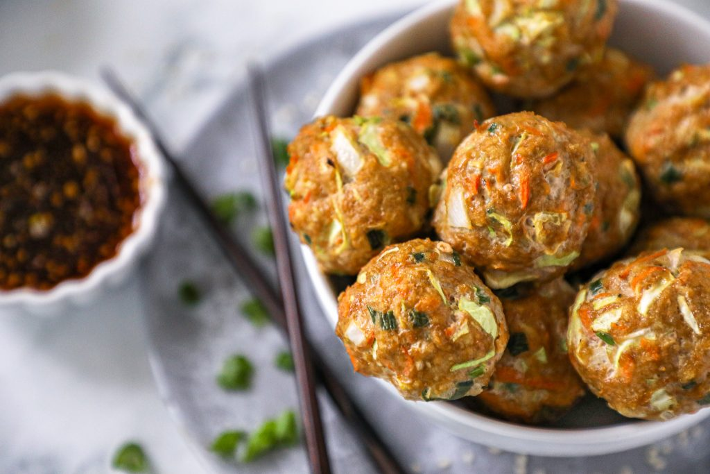 Delicious Asian inspired meatballs that take just minutes to make and are baked in the oven! They're healthy, low carb and can easily be made gluten free too!