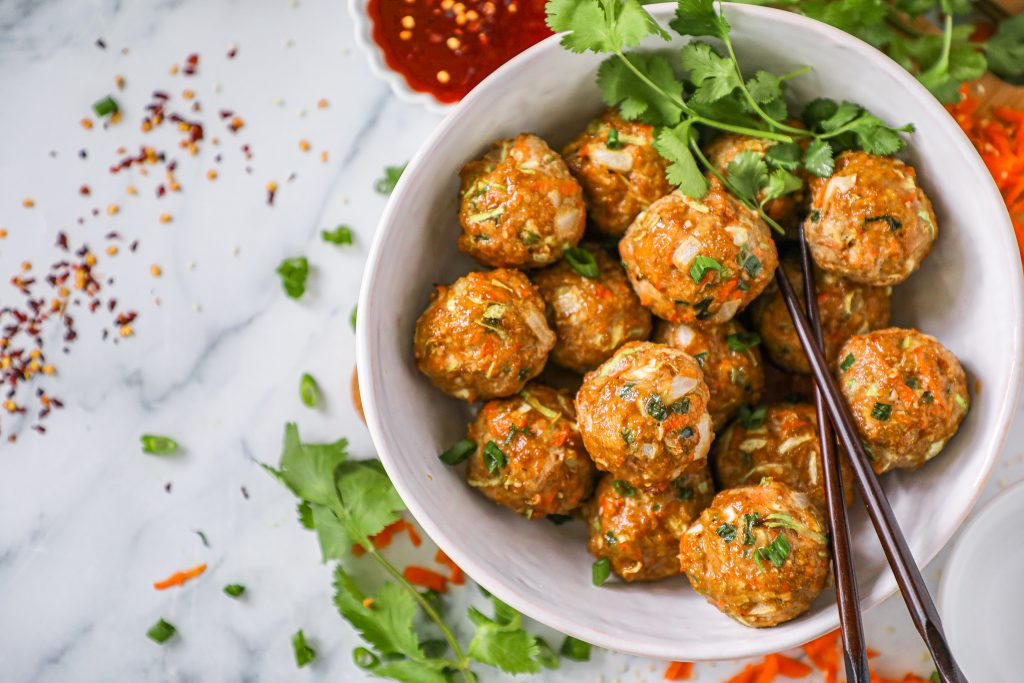 These egg roll meatballs are sticky sweet with just a light bit of spice! They're packed full of veggies and take less than 30 minutes to bake in the oven too! Plus they make for a great crock pot meal!