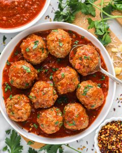 Easy Italian meatballs made with ground turkey and Italian spices and toss in a delicious homemade marinara sauce! They're perfect for a comforting weeknight meal!