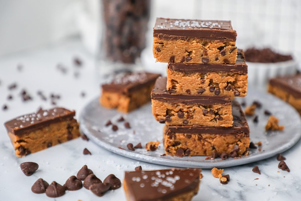 A simple recipe for healthy cookie dough bars that are made with almond butter, almond flour, maple syrup, chocolate chips and coconut oil. They're gluten free and egg free too!