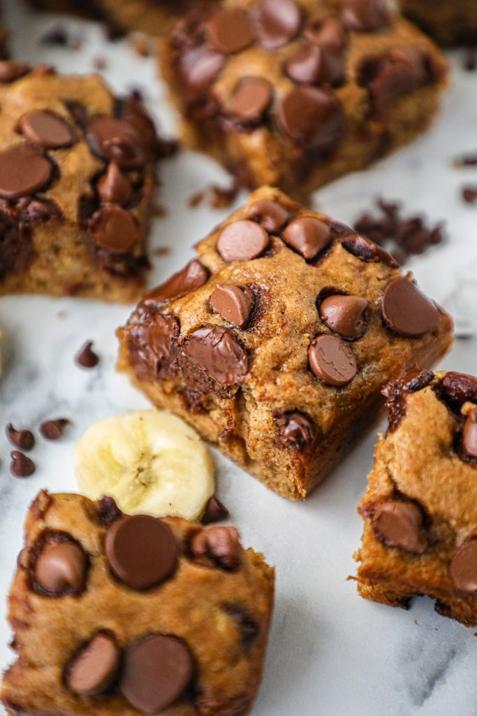Moist brownies made with bananas, coconut sugar, almond butter and chocolate chips. They're dairy and made with no oil too!