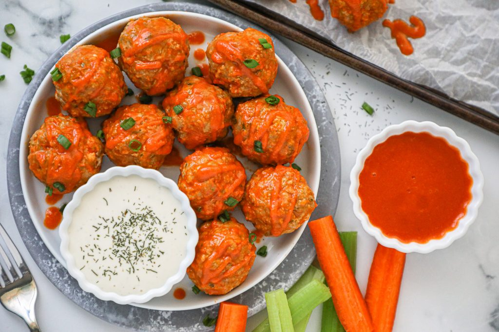 Delicious buffalo meatballs that are baked instead of fried and loaded with veggies! Plus they're easily made gluten free too!