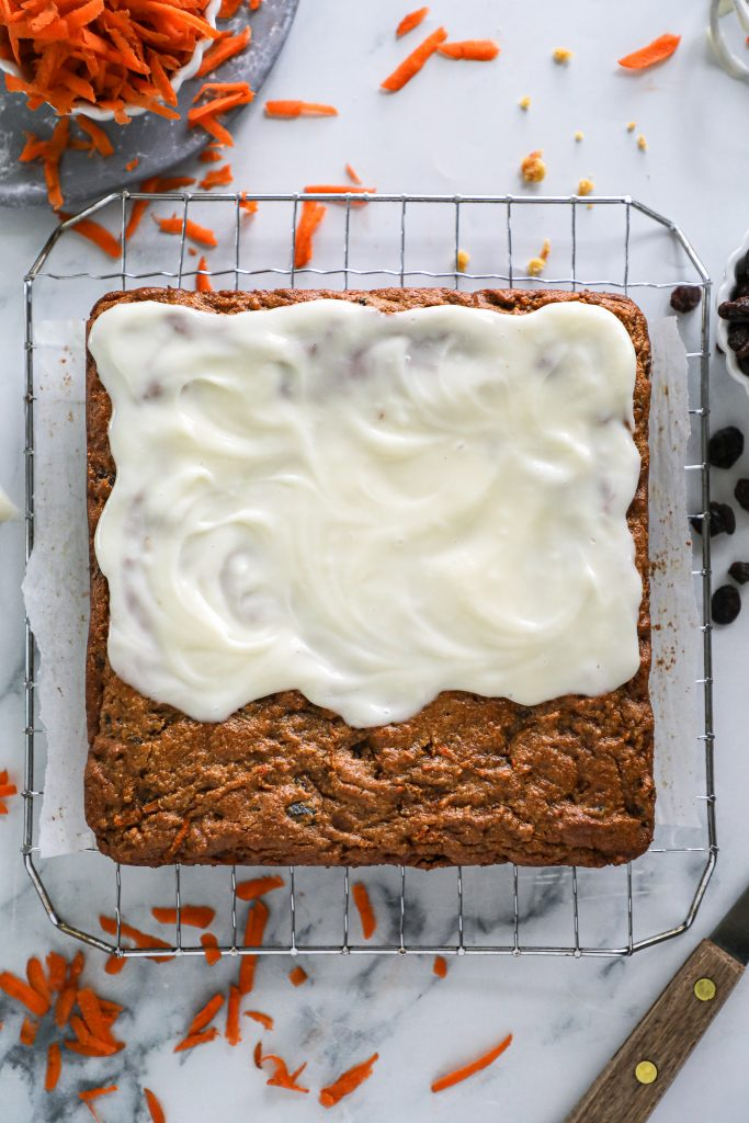 This delicious cream cheese frosting is lightened up with greek yogurt and pairs perfectly with any type of carrot cake!