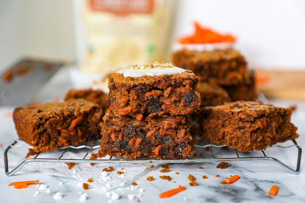 Easy carrot cake bars that are gluten free and dairy free too! Plus they're made with ingredients you already have in your pantry!