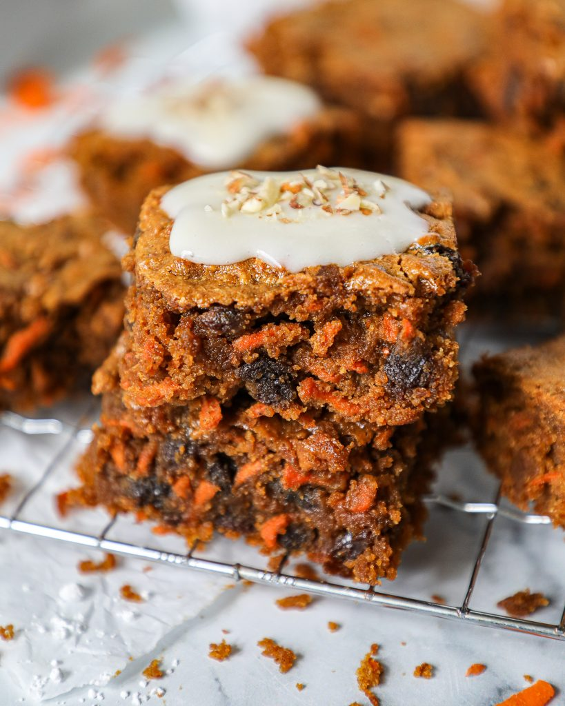 Grated carrots, plump raisins and a warm moist center. These decadent blondie bars are topped with a healthier cream cheese frosting for a rich and satisfying dessert!