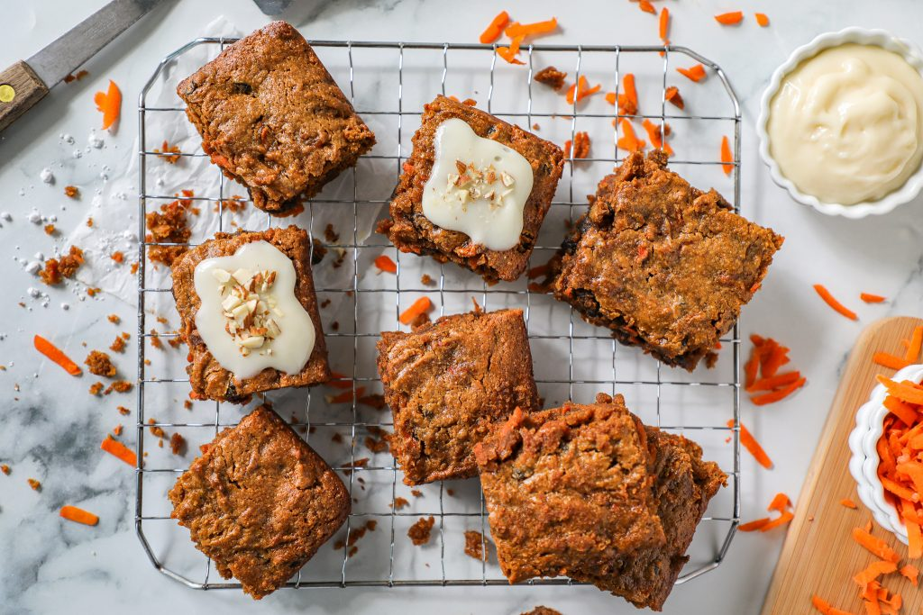 Spicy carrot cake gets paired with warm gooey blondies! This is one match made in heaven that's just perfect for Spring!