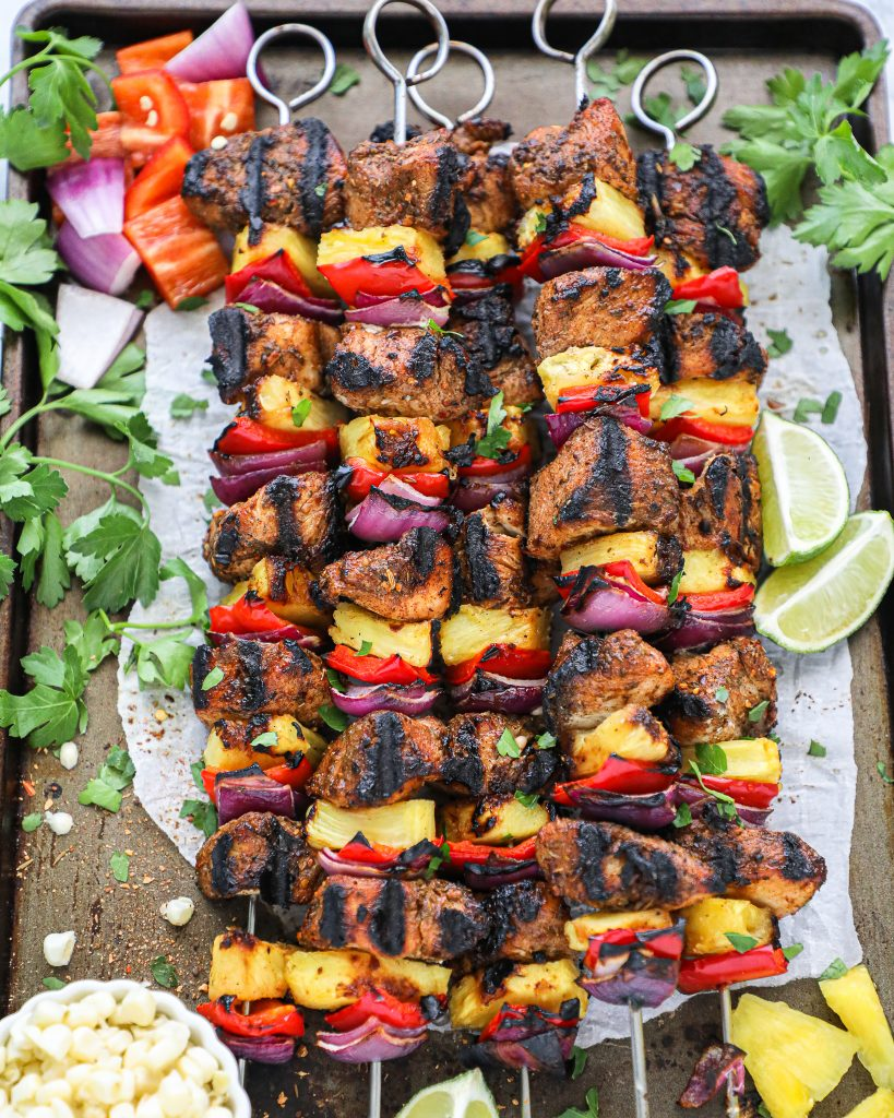 These delicious tropical skewers are made with spicy chicken pieces, pineapple chunks, red bell peppers and onions! And they only take 20 minutes to cook!