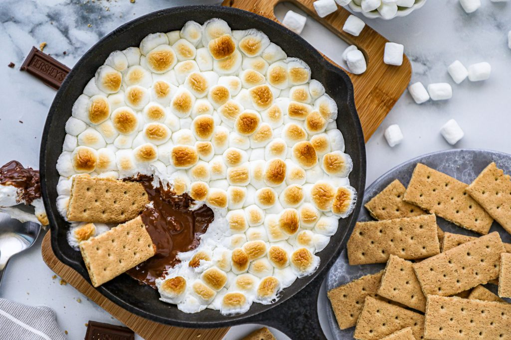 This s'more's skillet dip is a fun twist on your favorite summertime treat! It's easy to make, loaded with chocolate and gooey marshmallows and perfect to serve for a crowd!