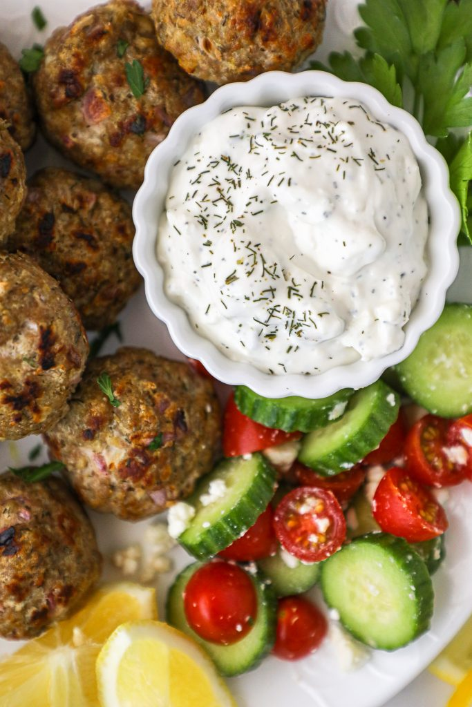 These Mediterranean meatballs are so versatile! You can pair them with tzatziki or hummus for a fun appetizer party or even toss them over a salad for a quick meal!
