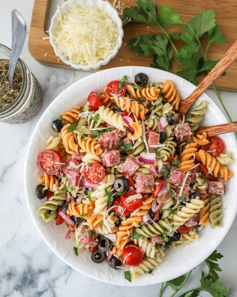 This incredibly easy pasta salad is light, tangy and loaded with fresh ingredients and Italian herbs! It's the perfect side dish to serve at your next barbecue!