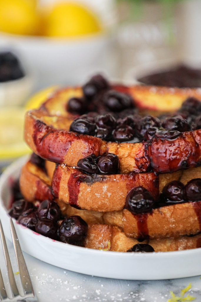 Thick fluffy slices of lemon french topped with a sweet blueberry compote! It doesn't get any better than this for a summery breakfast or brunch!