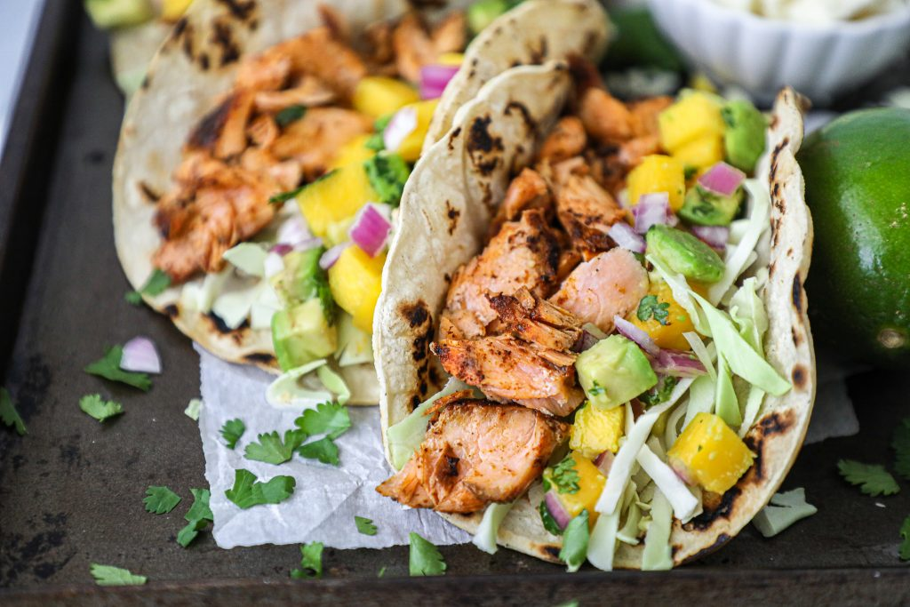 These incredibly flavorful salmon tacos are just what you need for summer! They're spicy, tangy and take no time at all to make!
