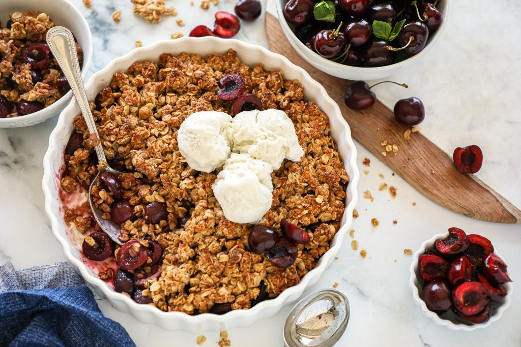This fresh cherry crisp is sweet, crunchy and so easy to make too! Serve it with some ice and you've got the perfect summer treat!