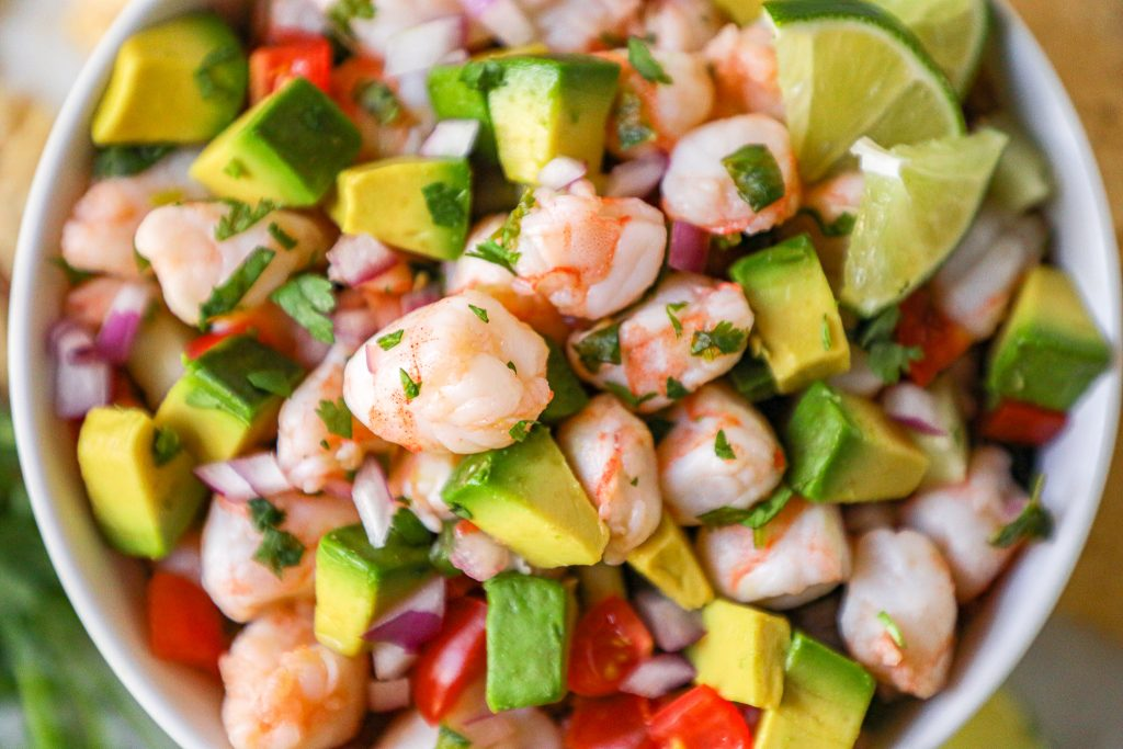 Fresh shrimp, tomatoes, cucumber, red onion, jalapeno and lots of lime juice and cilantro are all you need to make this tasty dish! It's the perfect appetizer or meal for summer!