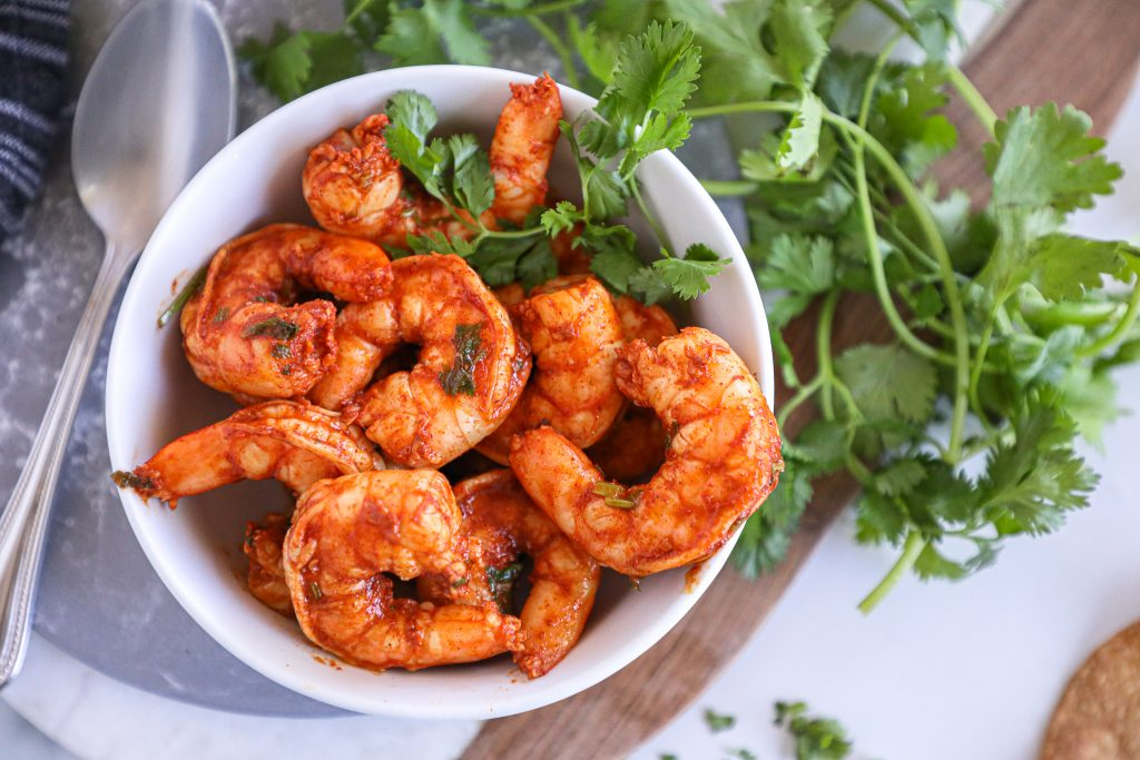 This chili lime shrimp is made with just a handful of ingredients and takes minutes to saute on the stove!You can put them on your tacos, salads, nachos or even eat them as is!
