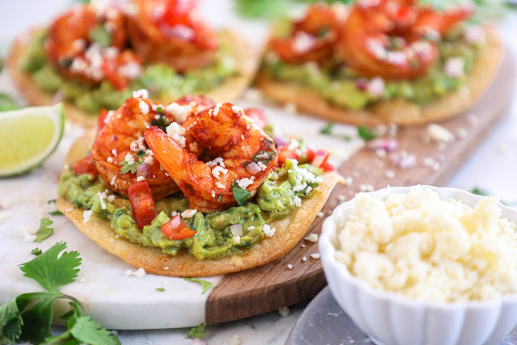 Spicy shrimp tostadas are such an easy meal for during the week! They take no time at all to make and are packed full with flavor!
