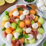 A light and refreshing summer salad made with summer melons, mozzarella balls, prosciutto and fresh basil! It's so easy to make and pairs well with everything!