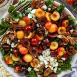 Cherry, goat cheese and pecan kale salad is such a great side dish for summer! It's light and refreshing and so easy to make too!