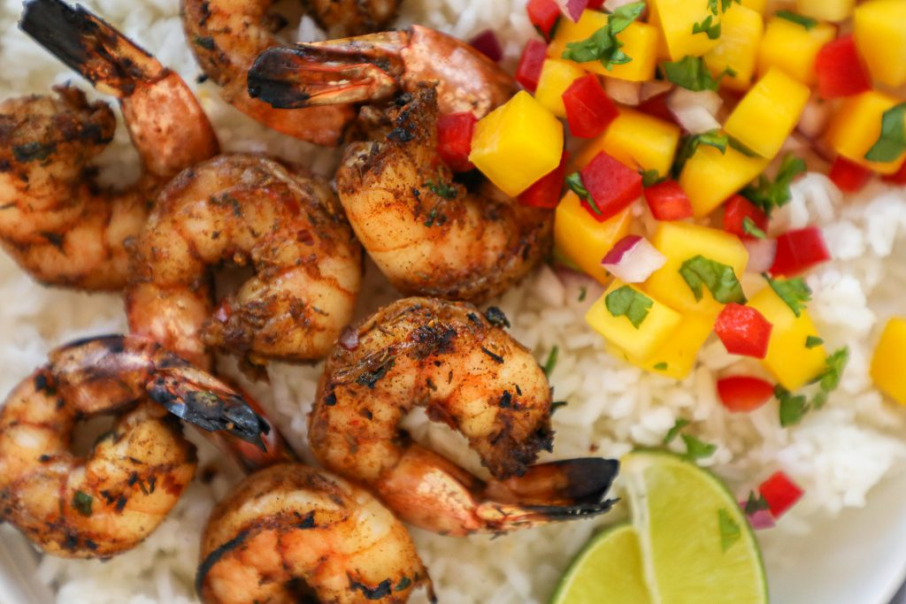 Looking for a healthy meal to be the heat? Try making jerk shrimp with mango salsa! It's sweet, spicy and full of Caribbean flavor!