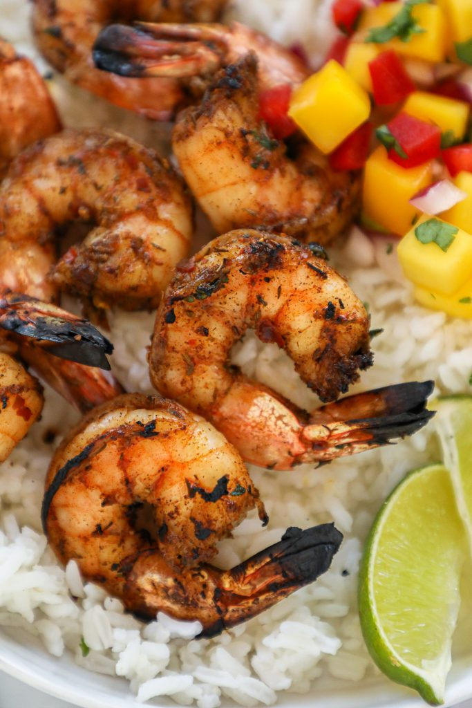 Grilled Jerk shrimp is the perfect dinner for summer because it's fast, requires few ingredients and can also be sauteed too! Plus it's also gluten free and dairy free too!