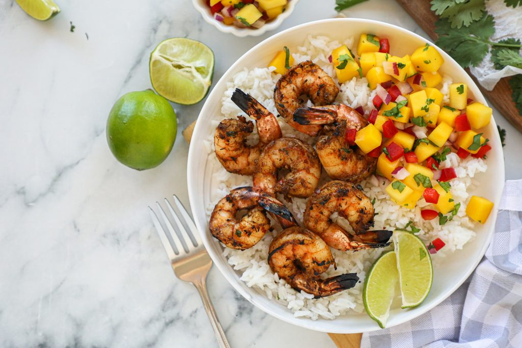 This easy weeknight meal is made with shrimp that's been seasoned with a store bought spice mix, cilantro and lime and can be grilled or sauteed.