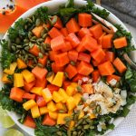 A healthy kale salad made with papaya, mango, toasted coconut and a tangy lime dressing! It's so refreshing and will instantly remind you of the tropics!