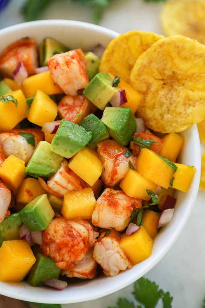 Don't turn your ovens on in this heat! Instead make this spicy shrimp, mango and avocado salad! You can serve it with chips, in a tortilla or even over a bed of lettuce!