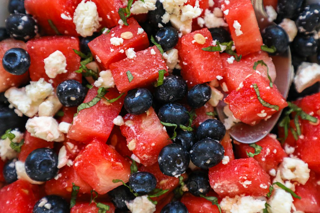 An easy watermelon salad made with cubed watermelon, blueberries, feta cheese, basil and a tangy lime dressing! It's such a refreshing side dish!