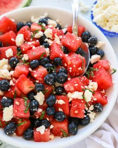 Watermelon, blueberry and feta salad is a light and refreshing side dish that's perfect for summer! It's easy to make and is always a crowd pleaser!