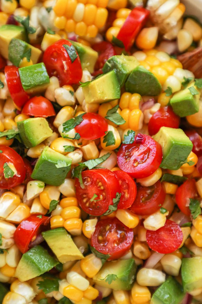 Fresh corn, grape tomatoes, red onion and cilantro are all tossed in lime juice to make this delicious and easy corn salad!