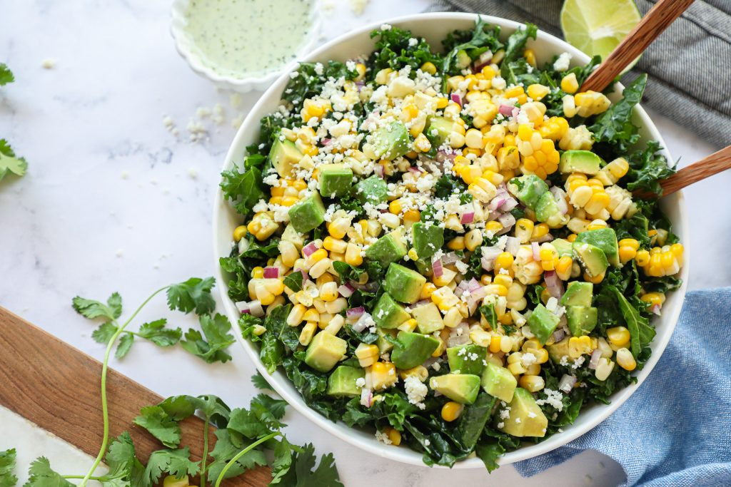 Simple, easy and packed with so much flavor! This zesty corn and kale salad is the perfect side dish for all your summer barbecues and potlucks!