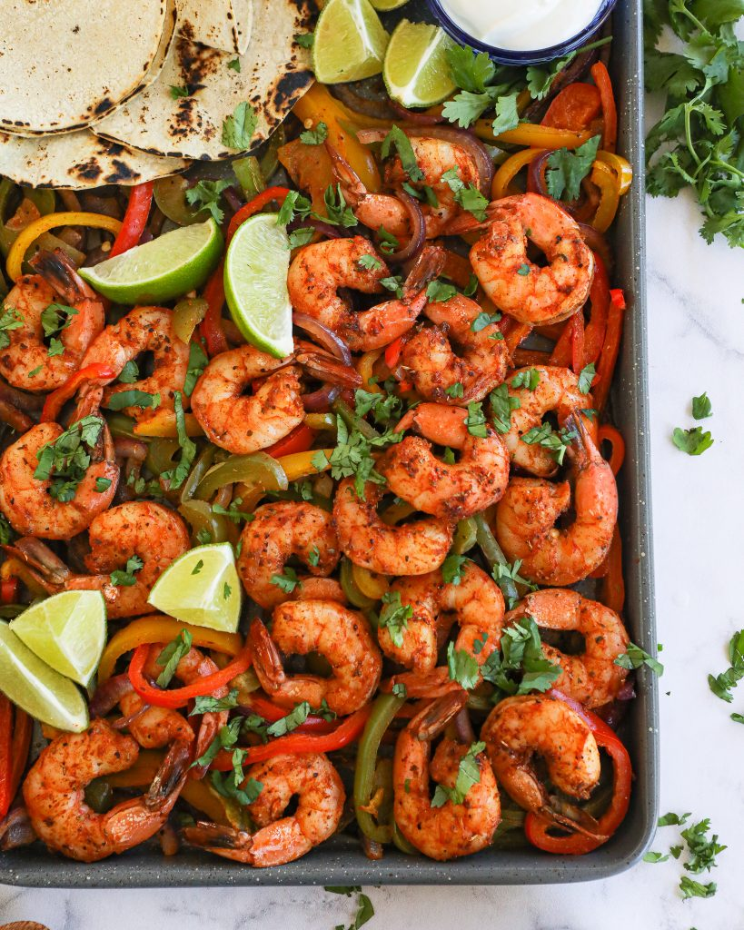 Sheet pan shrimp fajitas are a great option for an easy weeknight meal! They only take 15 minutes to cook, are super flavorful and there's hardly any clean up at all!