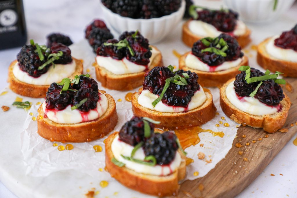 This simple blackberry and ricotta crostini is perfect for your next holiday or appetizer party! Plus all of the components can be made ahead of time too!