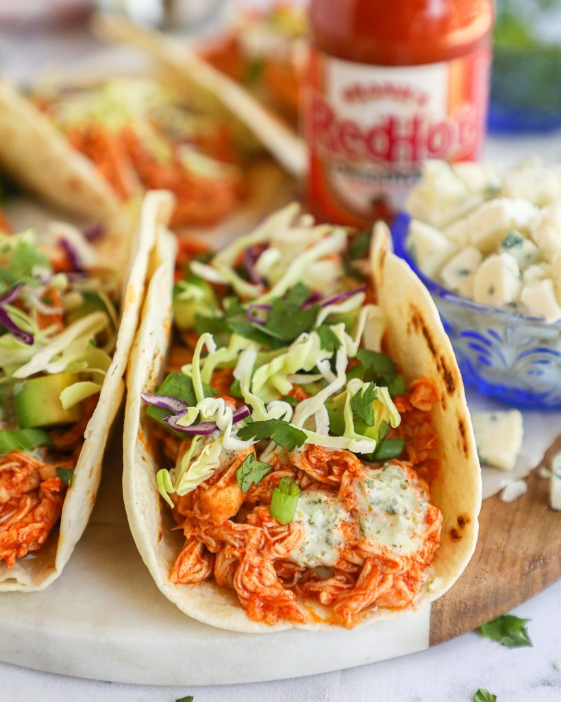 Are you a buffalo chicken lover? Then you're going to absolutely love these spicy buffalo tacos! They're so simple and are perfect for a quick dinner or lunch!
