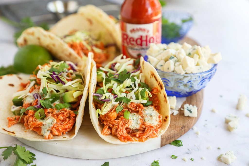 Looking for a quick meal idea? Try this delicious and easy taco recipe! It only takes 15 minutes to cook the chicken and the sauce can be made beforehand too!